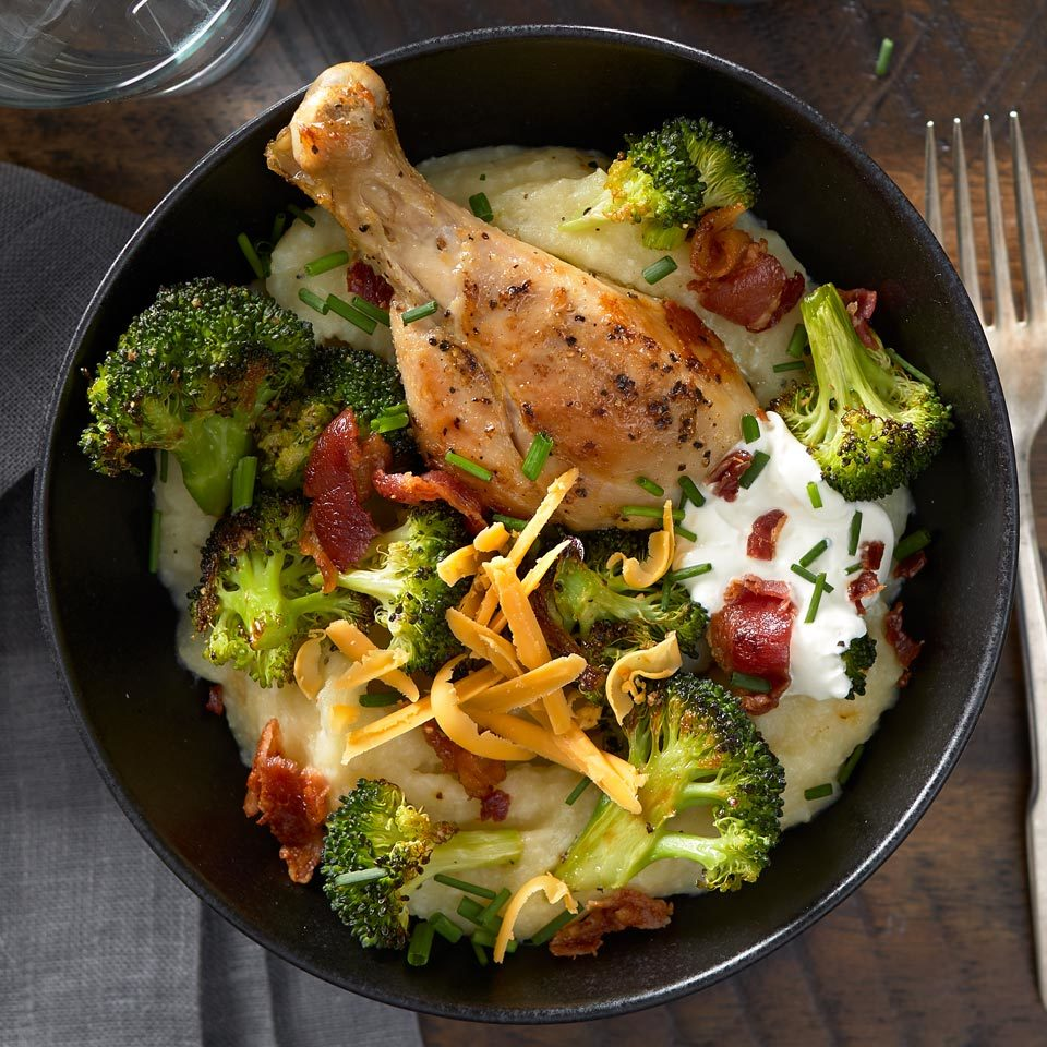 Cauliflower and potatoes mash into a creamy puree that has fewer calories than mashed or baked potatoes alone. Here, we top the puree with chicken and broccoli to make a satisfying and complete meal. The cheese, sour cream and bacon toppings make this easy dinner resemble a lower-calorie loaded baked potato.