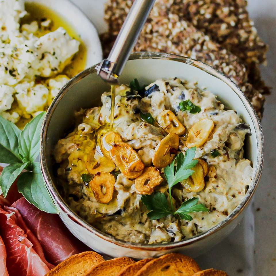 The smoky char of roasted eggplant meets the nuttiness of tahini and tang of lemon in this crowd-pleasing dip that's reminiscent of classic baba ganoush. We finish the dip with sizzled garlic and a drizzle of heart-healthy olive oil.