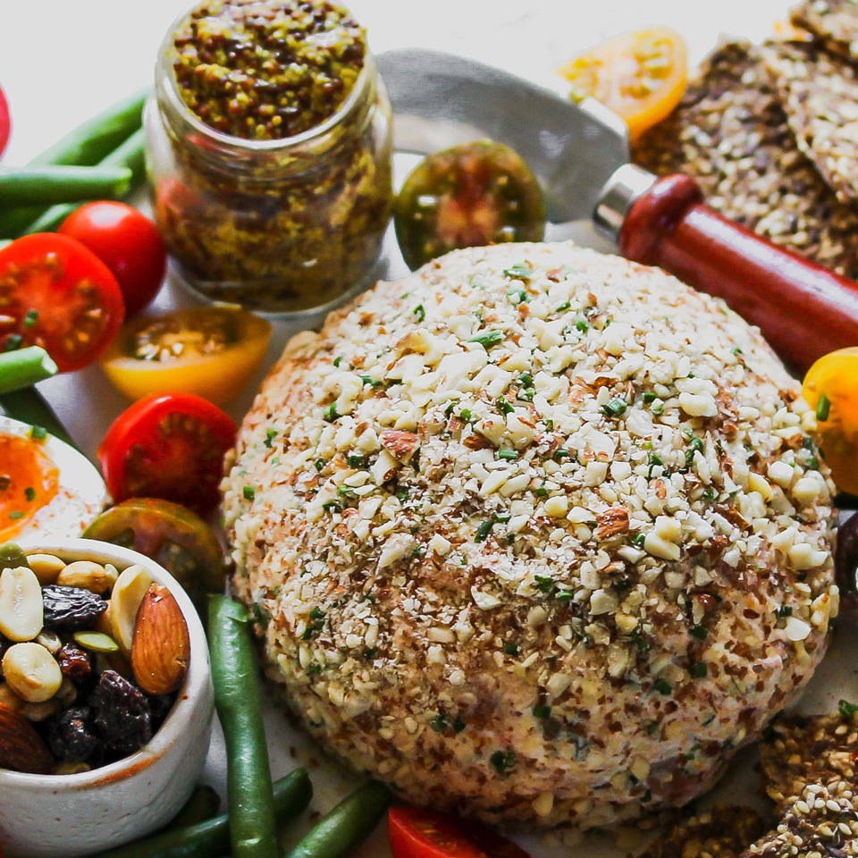Blanketed in chopped nuts and zesty chives, this cheese ball is festive enough for even the most discerning party guests. Serve with sturdy crackers or toasted baguette slices for easy spreading.