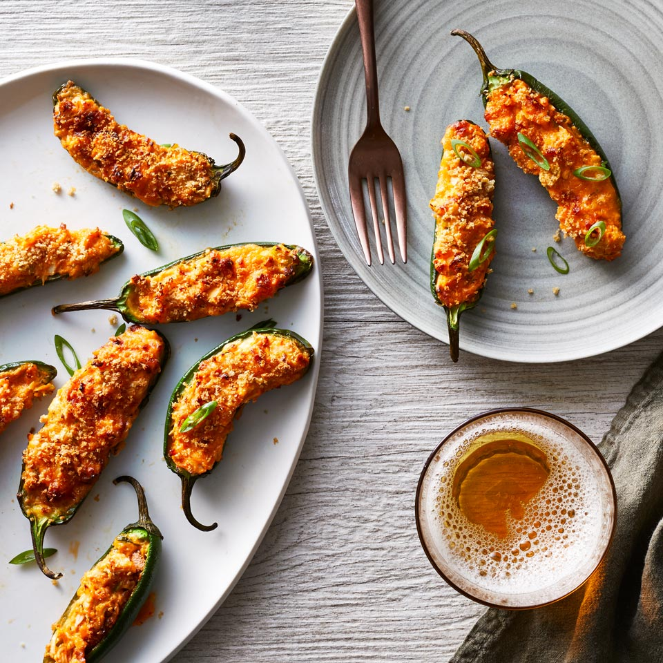 The perfect football-party food, classic jalapeño poppers get a crispy upgrade in an air fryer. Cream cheese tempers the just-right hint of heat from the peppers and Buffalo sauce. To save time, you can stuff the peppers ahead of the party and fry them just before serving.