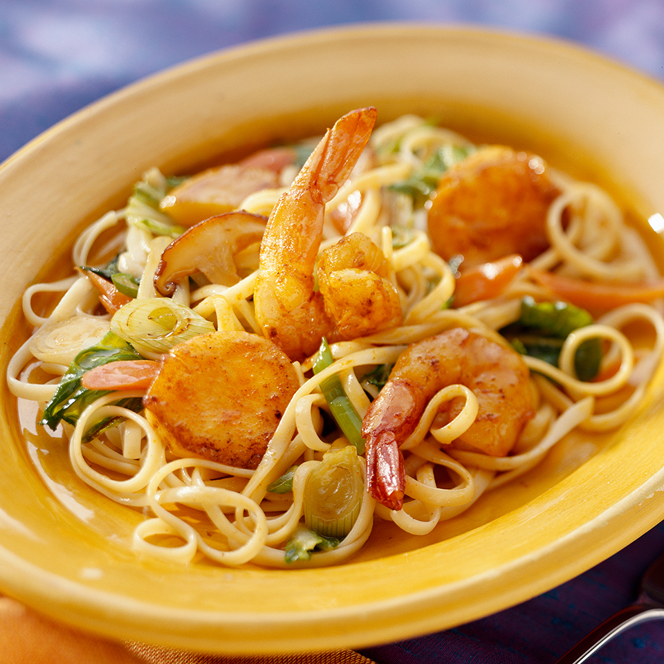 Apricot nectar adds a touch of sweetness to the soy- and ginger-based sauce flavoring this 25-minute seafood linguine recipe. The shrimp and scallops are coated with a curry mixture which adds taste and color to this delicious dish.