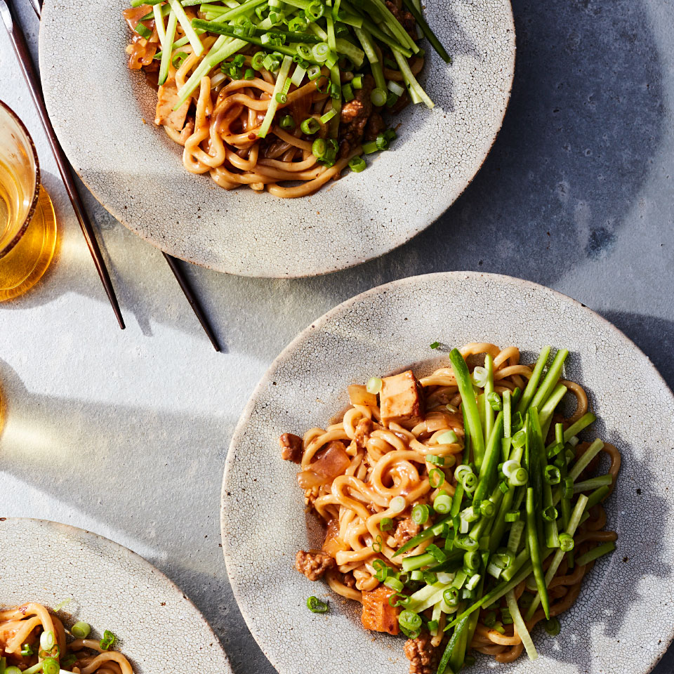 """The name of this flavor-drenched dish aptly translates to """"fried sauce noodles."""" A pork- and tofu-flecked sauce gets its savory powers from three layers of distinctive soy condiments. Tossed with thick wheat noodles, the result is satisfying and quite comforting."""