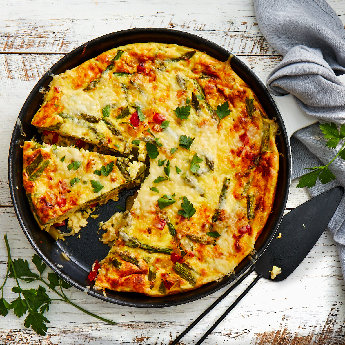 Perfect for a spring brunch or light supper, this Italian omelet is baked so it is easy to serve to a group.