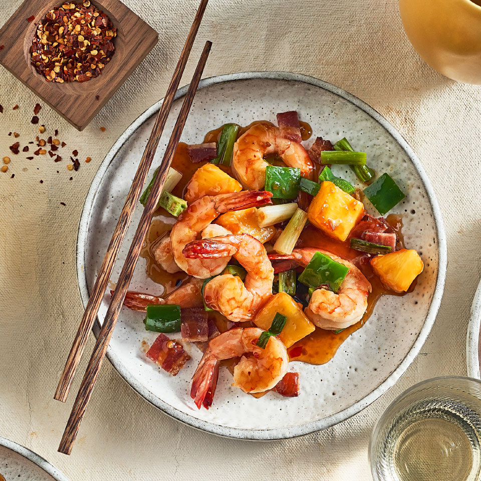 This sweet, spicy and super-easy shrimp-and-vegetable stir-fry starts with a very small amount of bacon in the wok, which creates drippings that add tons of smoky flavor to the vegetables and shrimp that go in next. Keep the salt in check by using reduced-sodium tamari sauce. To complete this easy healthy dinner, add cooked brown rice.