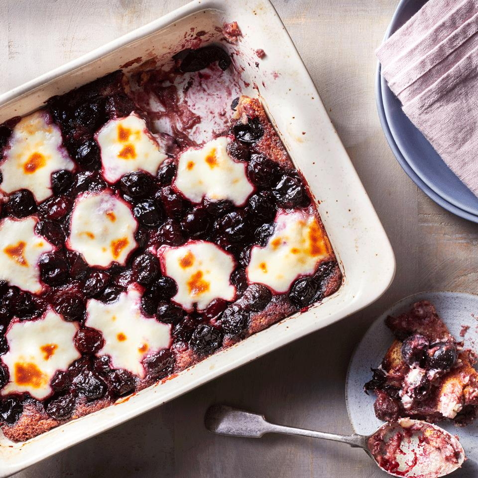 Classic cherry cobbler is studded with a sweetened cream cheese swirl in this easy cherry dessert you can make any time of year.