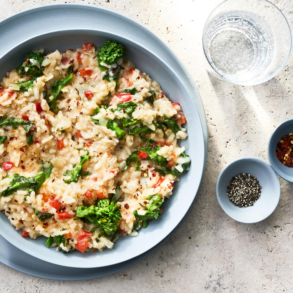 Sweet red bell pepper balances the bitterness of broccoli rabe in this vegetable risotto recipe. If you can't find broccoli rabe, use chard instead. For an easy risotto method, we've also included instructions for making this dish in the microwave. Make it a meal: Serve with Arugula & Strawberry Salad.