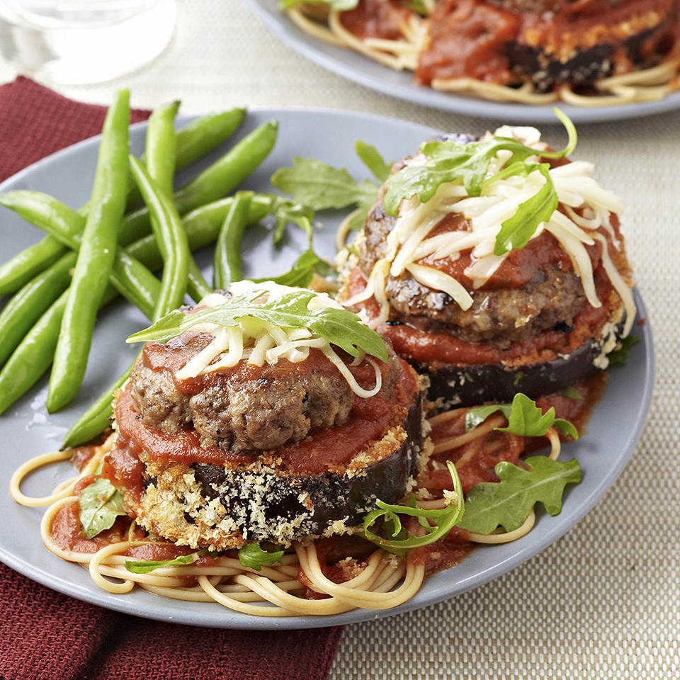 This cheeseburger and eggpant Parm fusion recipe is a winning combination. Breaded eggplant slices are topped with marinara sauce, mozzarella cheese, and a delicious grilled lean beef burger—it's American classic meets Italian restaurant favorite! To make it a complete meal, serve with spaghetti with a side of steamed vegetables.