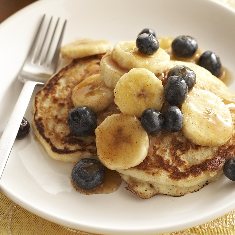 Perfect for a lazy weekend breakfast, these buttermilk pancakes are taken to new heights with a banana and blueberry maple syrup topping.