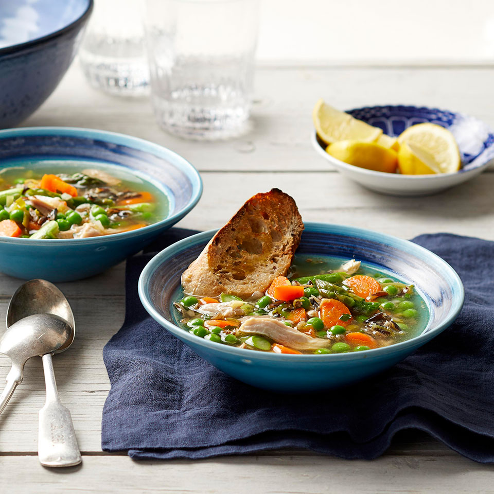 Use your crock pot all year with this healthy slow-cooker chicken soup recipe with fresh spring ingredients. Adding the asparagus and peas to the slow cooker for the last 20 minutes of cooking and leaving the lid off ensures that the vegetables stay bright green and are perfectly done without getting mushy.