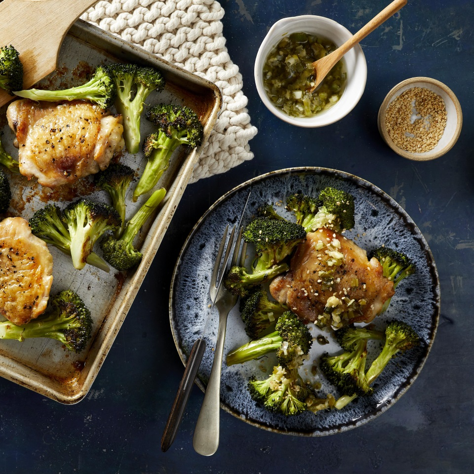 In this healthy sheet-pan chicken recipe, meaty bone-in chicken thighs and broccoli florets are tossed with sesame oil and roasted on the same pan for a delicious and easy dinner with minimal cleanup. While the chicken and broccoli cook, whip together the simple scallion-ginger sauce. The sauce would also be wonderful spooned over salmon, tofu or grain bowls; it is easily doubled or tripled!