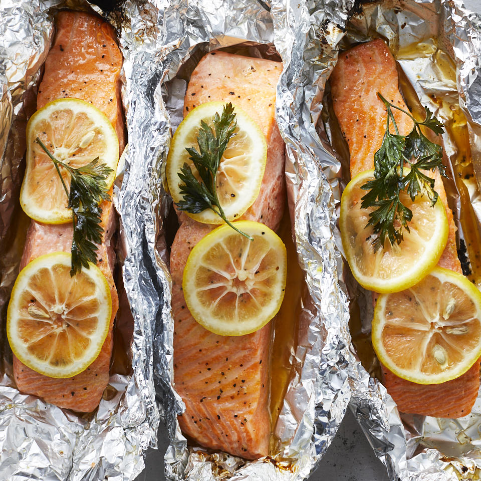 We're willing to bet that this easy grilled salmon in foil recipe will become a regular in your weeknight dinner rotation. Cooking fish in foil keeps it super-moist, plus you don't have to worry about the fish sticking to the grill. Butter, lemon pepper and fresh parsley perk up the flavors for this versatile main course. Cook some vegetables, such as asparagus, zucchini and corn, alongside the fish packets for a healthy dinner that's ready in less than 30 minutes.