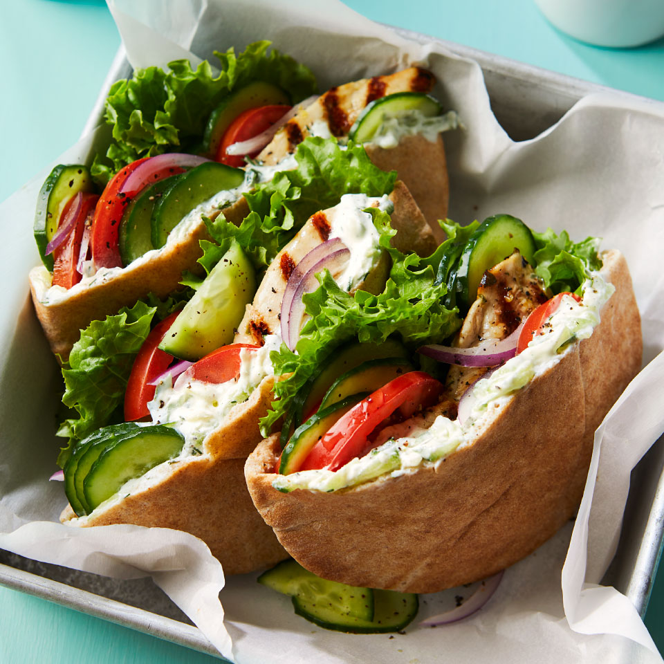 Cucumbers do double duty in this healthy Greek chicken pita recipe—they're grated to lend a refreshing flavor to the quick cucumber-yogurt sauce and sliced to provide cool crunch tucked into the pita. Serve these Mediterranean sandwiches for a healthy dinner or light lunch.