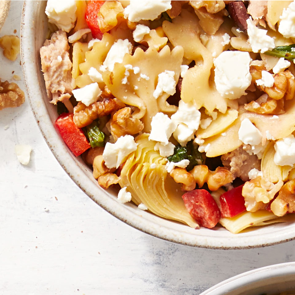 You might not think to use hummus as a pasta sauce, but the creamy dip makes the perfect backdrop to the bold flavors of this healthy Mediterranean-inspired pasta salad.