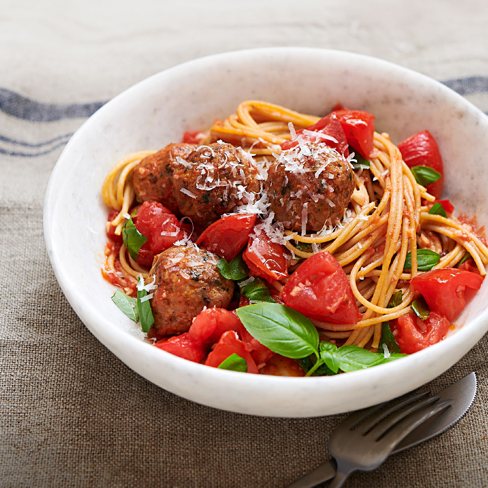 This crowd-pleasing and easy dinner recipe takes just 20 minutes to make, start to finish, so it's perfect for weeknights! When tomatoes are at their in-season best, just a quick chop and a few ingredients are all you need to make a spaghetti sauce in minutes. Store-bought chicken meatballs keep the low-effort theme going all the way to the table.