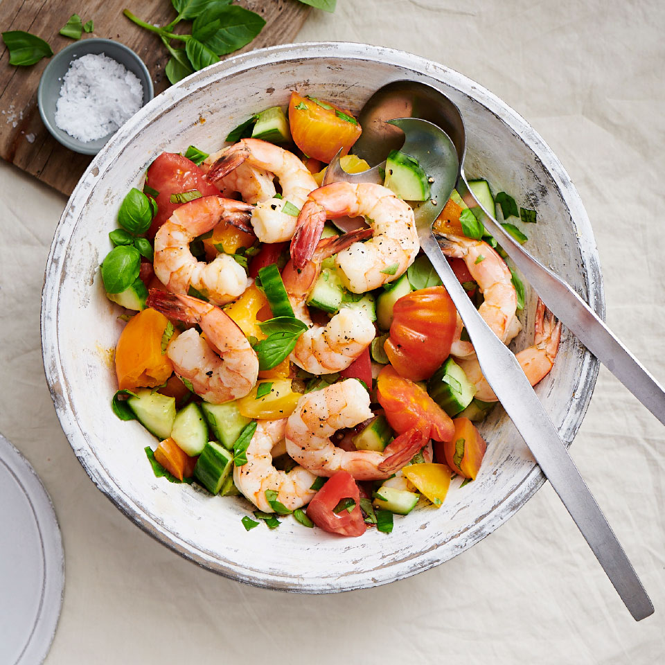 Use an array of colorful tomatoes to make this healthy shrimp salad pop. Cooking the shrimp with fresh herbs and garlic infuses them with flavor without coming off too strong for a light dinner salad that's perfect for summer entertaining.