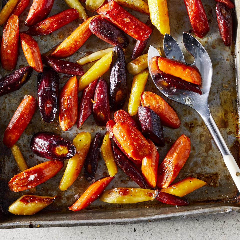 Roasting carrots brings out their sweetness, which is enhanced further with a tangy balsamic and maple glaze. Serve them straight-up for an easy weeknight side dish or garnish with chopped hazelnuts for holiday meals and dinner parties.