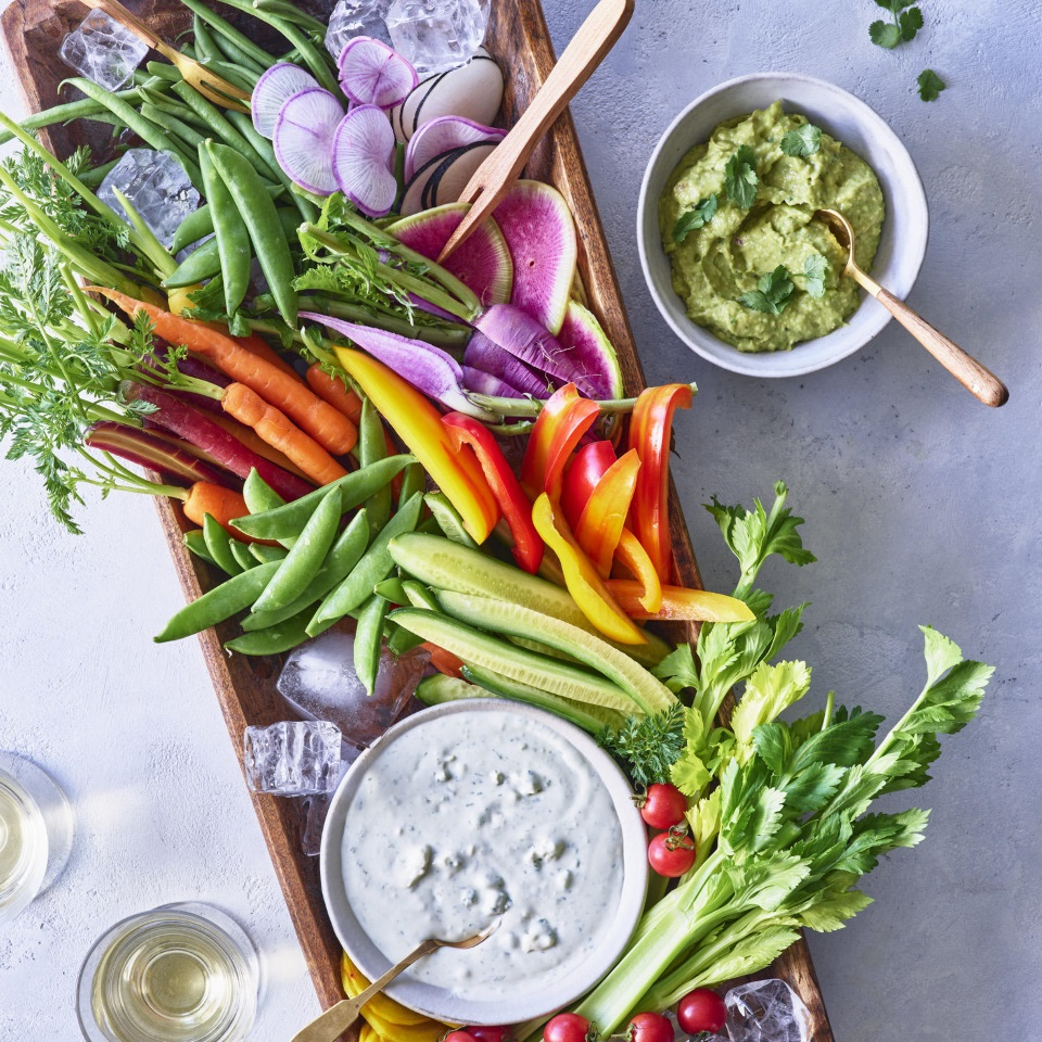 This beautiful and healthy appetizer board will be the talk of all your summer parties. Just assemble a colorful assortment of crunchy vegetables for dunking in two dips—a cooling herbed blue cheese and a spicy avocado hummus that play very nicely together.