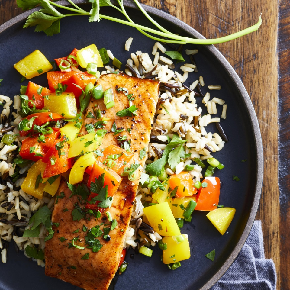 Fresh jalapeños give this quick and easy roasted salmon dish its kick; honey and balsamic vinegar give it a sweet finish. A nutty-tasting wild rice pilaf completes this healthy dinner that comes together in just 30 minutes.
