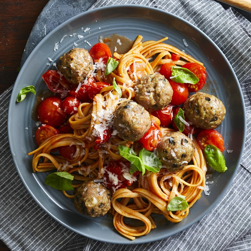 For this healthy turkey meatball recipe, lean ground turkey is mixed with fresh mushrooms, oats, garlic, spices and a little Parmesan cheese for a meatball that's moist, delicious and has more fiber and less saturated fat than a traditional beef and pork version. Serve these tasty meatballs over whole-grain pasta with fresh tomato sauce for a satisfying take on spaghetti and meatballs, and save the leftovers to stuff into sandwiches.