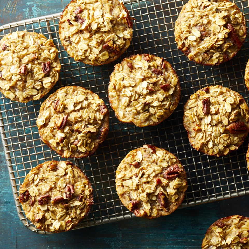Muffins meet oatmeal in these moist and tasty grab-and-go oatmeal cups. Feel free to swap out the pecans for any other nut—walnuts would be great—or omit them altogether. Make a batch on the weekend and keep them in your fridge or freezer for quick and easy breakfasts all week. Reheat in the microwave for about 40 seconds.