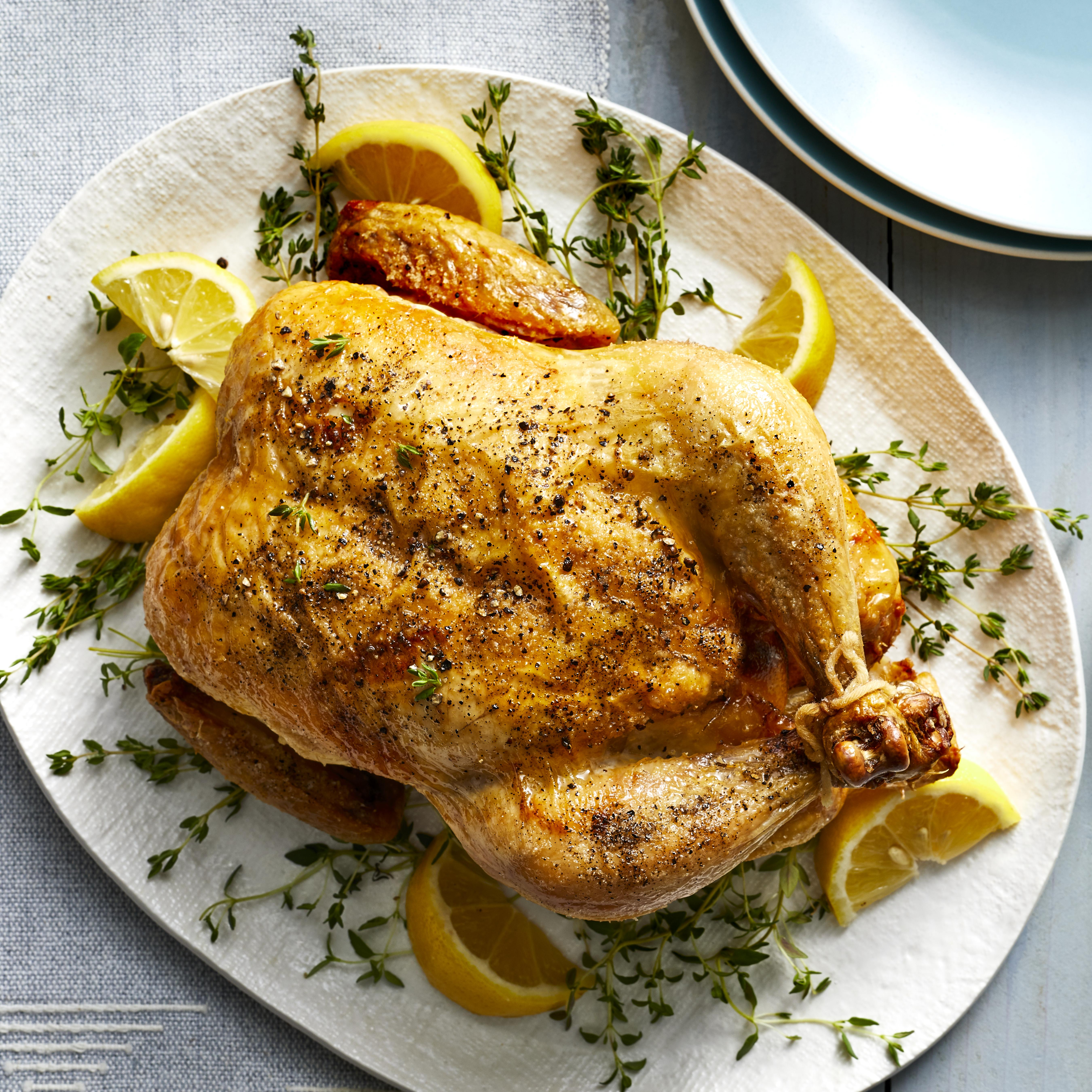 Replicate the flavor, lovely burnished skin and moist texture of a classic rotisserie chicken with this easy recipe for cooking a whole chicken in your air fryer. With just a handful of ingredients and 10 minutes of active time, you get a roast chicken with lemon and herbs that's a remarkable doppelganger for a deli chicken right after it comes out of the rotisserie—before it gets shriveled and dried out from sitting in the deli's holding case for hours. Serve this chicken with your favorite veggie sides for a healthy weeknight dinner or weekend supper. And if you're hosting a dinner party, cooking your main course in the air fryer is also a great way to free up oven space for casseroles, rolls and other dishes.