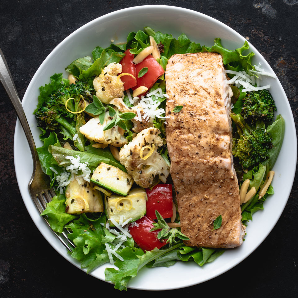 If mixed salads fail to fill you up, try this hearty Greek salmon salad recipe, which calls for bulking up a traditional bed of mixed greens with roasted vegetables and protein-rich salmon. Leftovers make it a breeze to put together this delicious Mediterranean salad. Here we suggest two recipes you could meal-prep ahead of time—Lemon-Roasted Mixed Vegetables and Sweet & Spicy Roasted Salmon—but you can use whatever roasted veggies you have on hand and pick up a precooked salmon fillet from the deli counter at your grocery store. This healthy salad would also be good with chicken. Serve it for an easy dinner or pack it up for lunch.