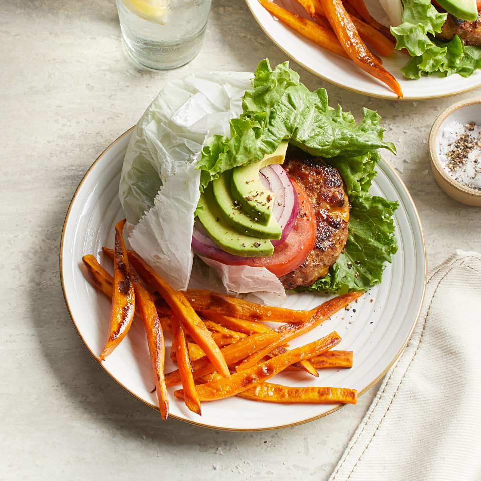Inspired by an option at the West Coast chain In-N-Out Burger, this turkey burger recipe keeps the carbs in check with a lettuce wrap instead of a bun. The side of sweet potato fries bakes while you prep the burgers, so this entire healthy dinner is ready in under 30 minutes.
