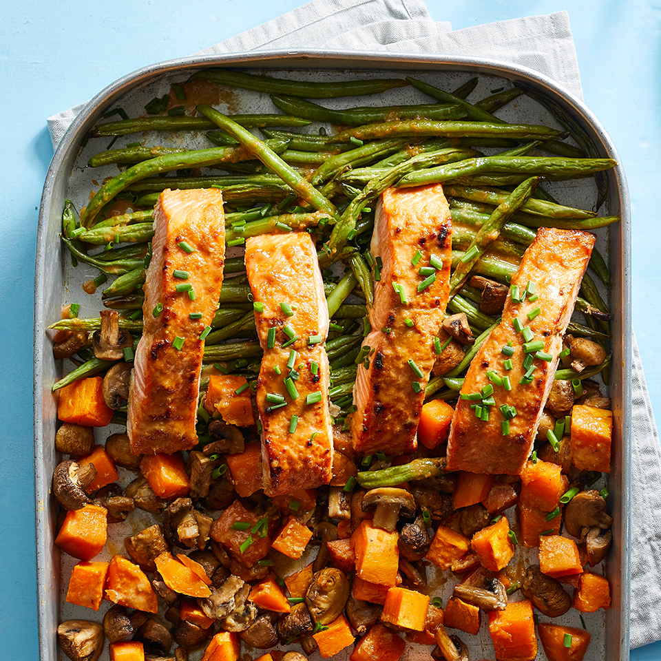 The tahini sauce does double duty in this healthy salmon recipe, serving as a glaze for the fish and also as a drizzle for the entire dish at the end of cooking. The green beans are cooked just slightly in this recipe, to still be crisp. If you like your green beans tenderer, look for thinner beans or haricot verts in the grocery store; they'll cook more quickly. This sheet-pan dinner recipe is not only delicious—it also comes together with just 25 minutes of active prep time, and there's only one pan to clean up afterwards!