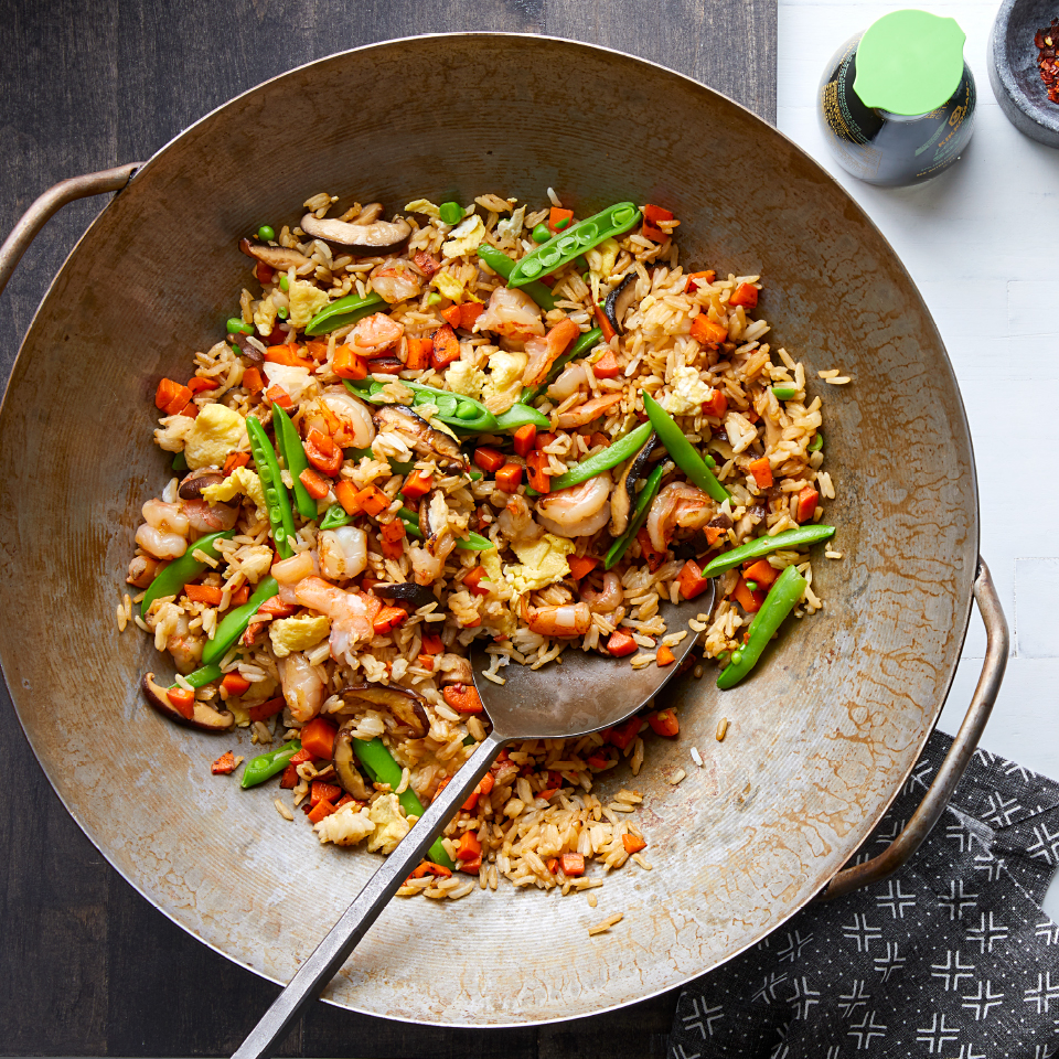 This healthy egg, vegetable and shrimp fried rice comes together in about 30 minutes for a delicious dinner you can make any day of the week. Fried rice is traditionally made with leftover rice cooked a day ahead; this recipe simplifies the process by cooking the rice together with the rest of the meal.