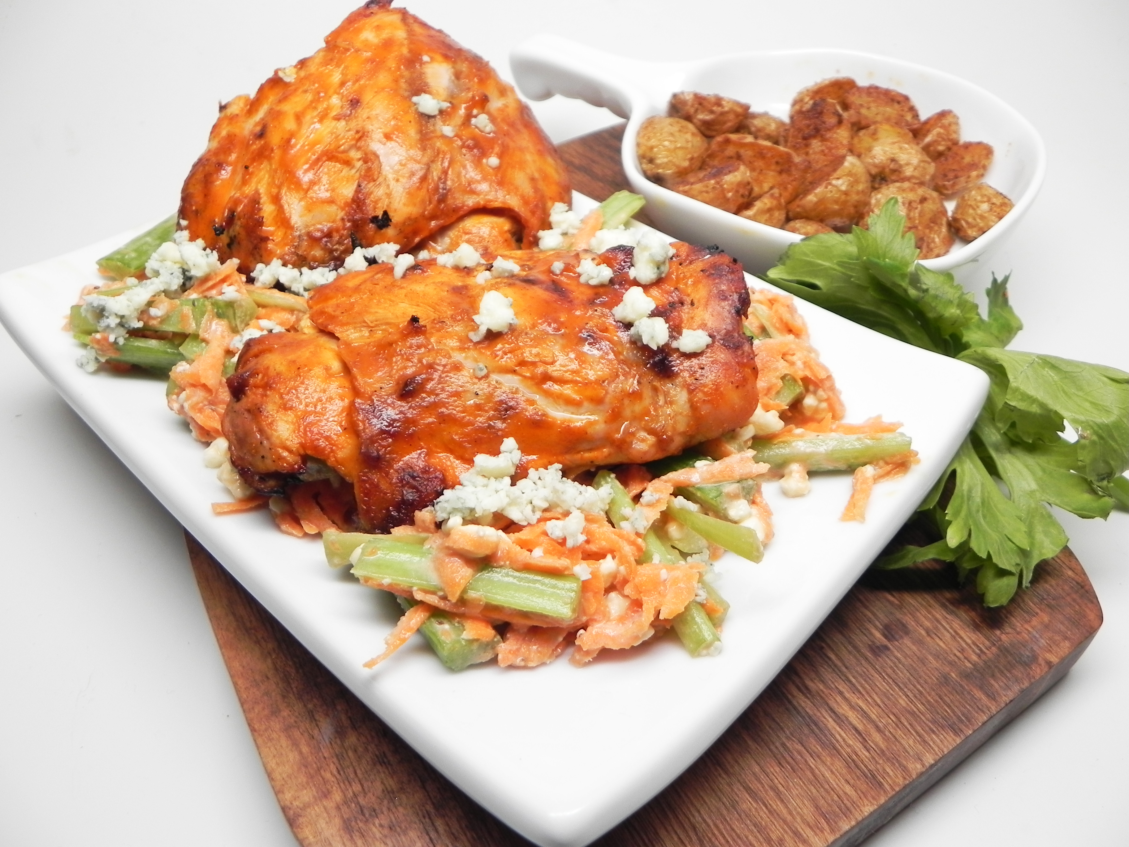 Grilled Buffalo Chicken Thighs with Blue Cheese Slaw