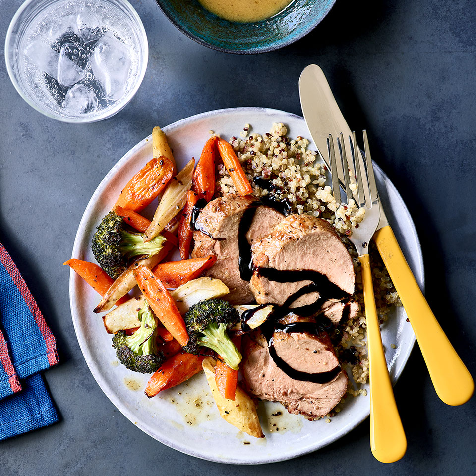For the best flavor in this easy roasted pork tenderloin dish, start marinating the pork the night before or get it going before you head off to work in the morning. Then, when you get home, all that's left to do is roast the pork and vegetables and prepare the quinoa for this easy healthy dinner. This recipe makes extra quinoa—use the leftovers as a base for easy meal-prep lunches, salads, stir-fries later in the week.