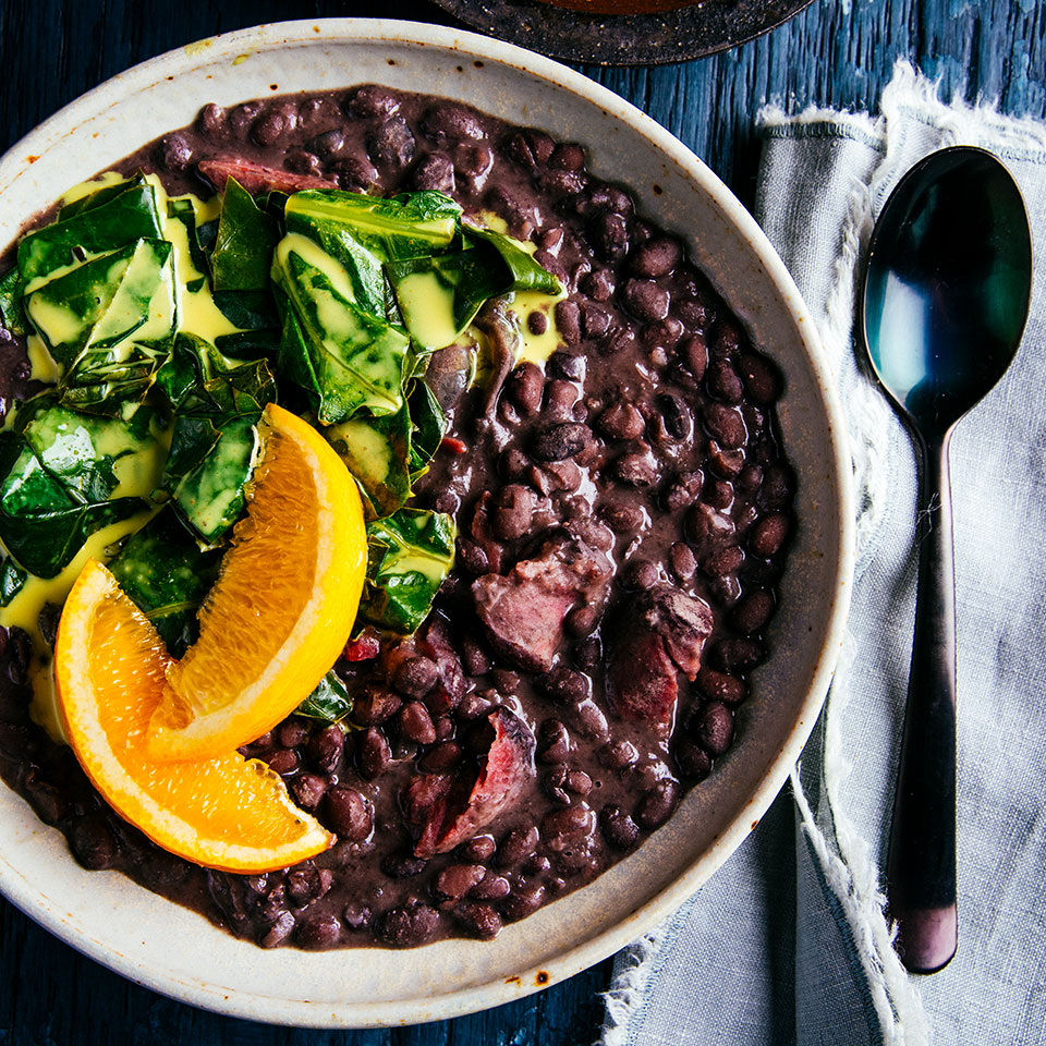 Cooking black beans in a slow cooker with a ham hock gives them a wonderful smoky flavor. Don't forget to soak your beans overnight for the creamiest, most luscious results. Serve over brown rice with lemon-curry collard greens for an easy healthy dinner that's super-satisfying.