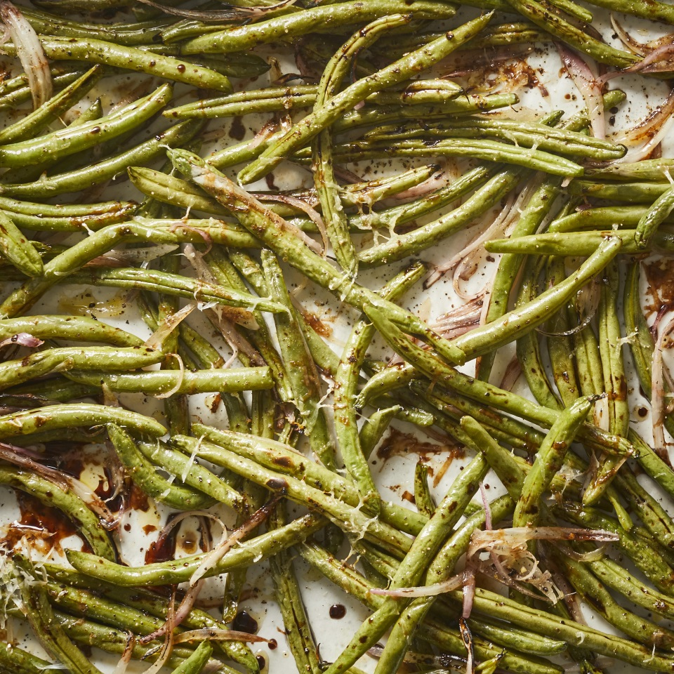 Sweet balsamic vinegar and nutty Parmesan cheese complement roasted green beans and shallots in this easy and healthy side dish. Roasting the green beans gives them a sweet, caramelized flavor while they still retain some bite. Serve with chicken, fish, pork—you name it. These green beans are also a wonderful addition to your Thanksgiving meal.
