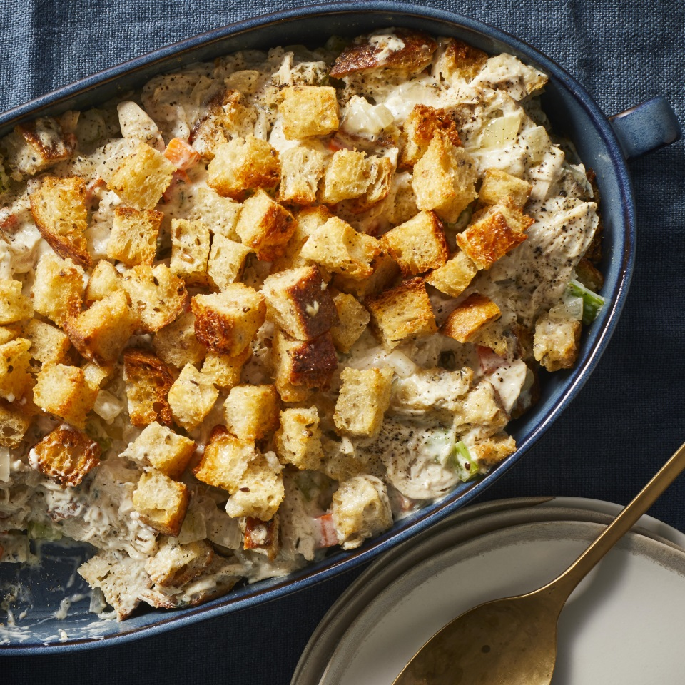 Stuffing is not just for Thanksgiving with this easy chicken and stuffing casserole. And speaking of Thanksgiving, if you have leftover turkey, feel free to substitute it for the chicken in this comforting and healthy recipe. It's also a great use for extra carrots, celery, onions and day-old bread you might have on hand around the holidays. There's no boxed stuffing mix or canned soup in this lighter take on the comfort-food casserole, but it's still super-easy to make. Poultry seasoning helps humble bread to taste like stuffing, while thickened chicken broth takes the place of canned soup. There are plenty of veggies in this one, too, making this a healthy casserole you can feel good about serving year-round.