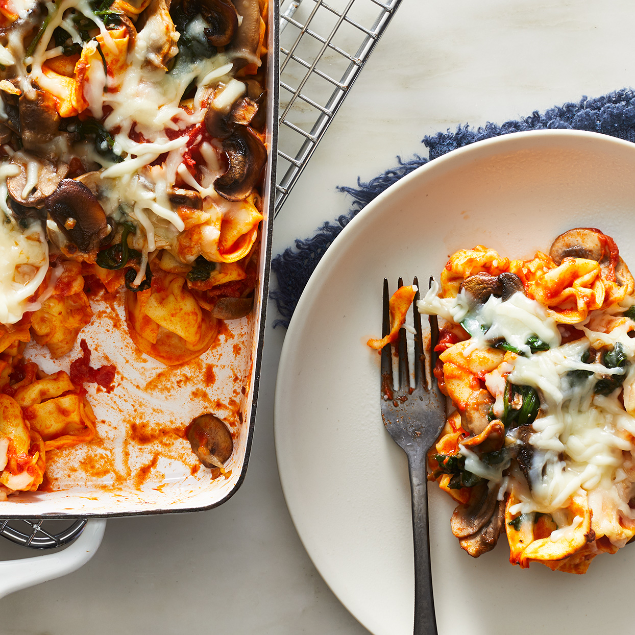 This cheesy tortellini bake is a dish the whole family will love—it's filled with sweet-tasting marinara, mushrooms and spinach and topped with melted cheese. Complete the meal, plus get in another vegetable serving, by adding a side of broccoli or a small green salad.