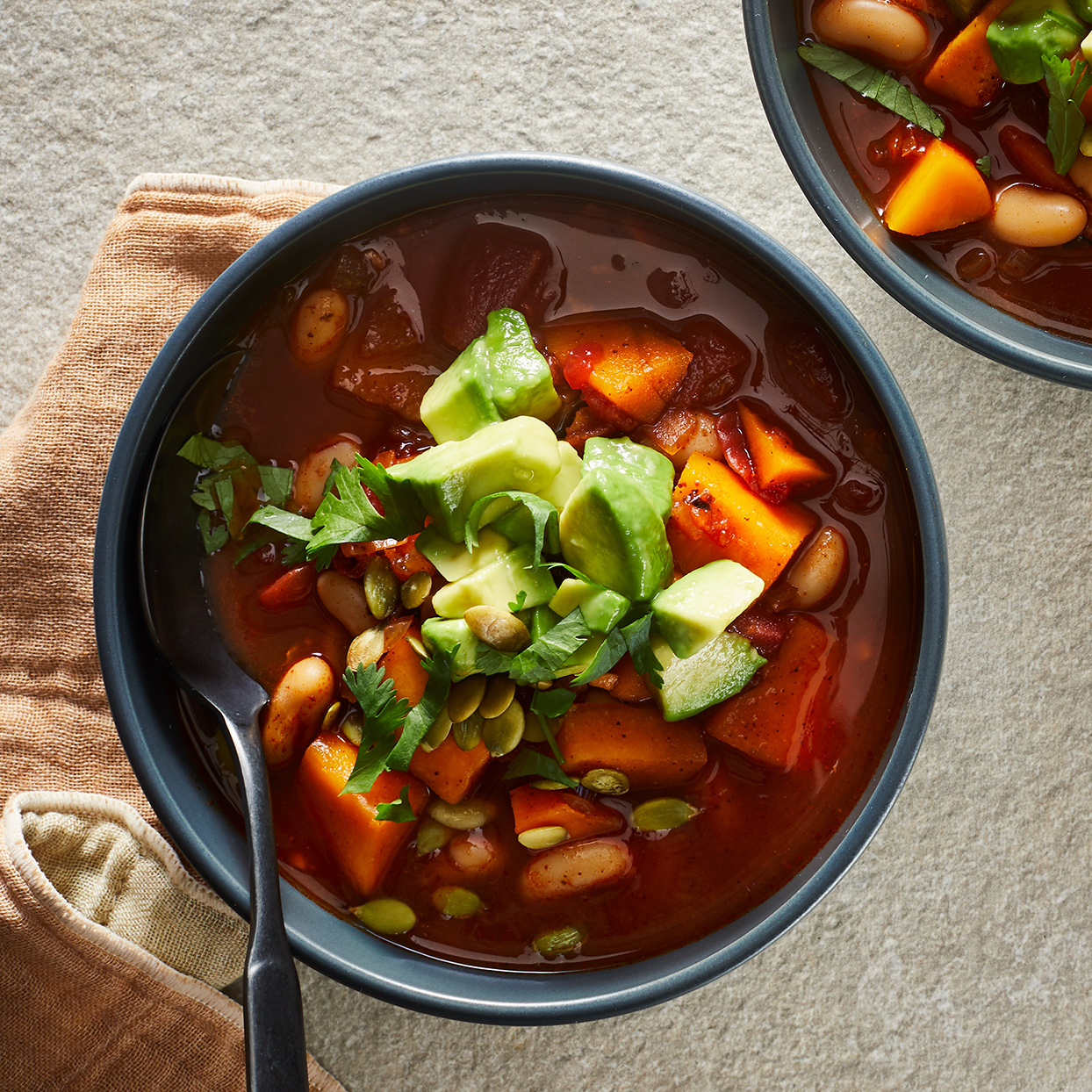For a quick-cooking soup, this one-pot, high-fiber vegetarian chili is deeply flavorful—so much so that tasters couldn't believe it was meat-free! We add a little flour and cook the stew with the lid off to thicken the chili and give it a hearty texture.