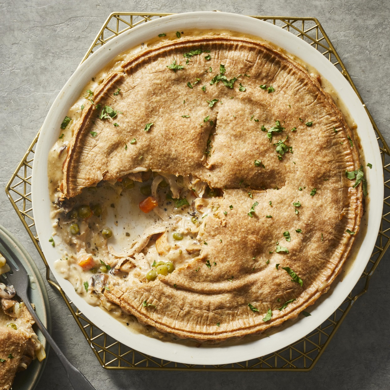 You might look forward to the days after Thanksgiving even more than the holiday itself with this easy turkey potpie recipe that's the perfect use for leftover turkey and extra vegetables like carrots and onions you might have on hand from the holiday. The pie is loaded with veggies and a creamy sauce, then topped with a prepared whole-wheat crust so there's no need to make dough. No leftover cooked turkey? This healthy potpie is just as delicious with chicken. Serve it up any time you need a dose of comfort food for dinner.