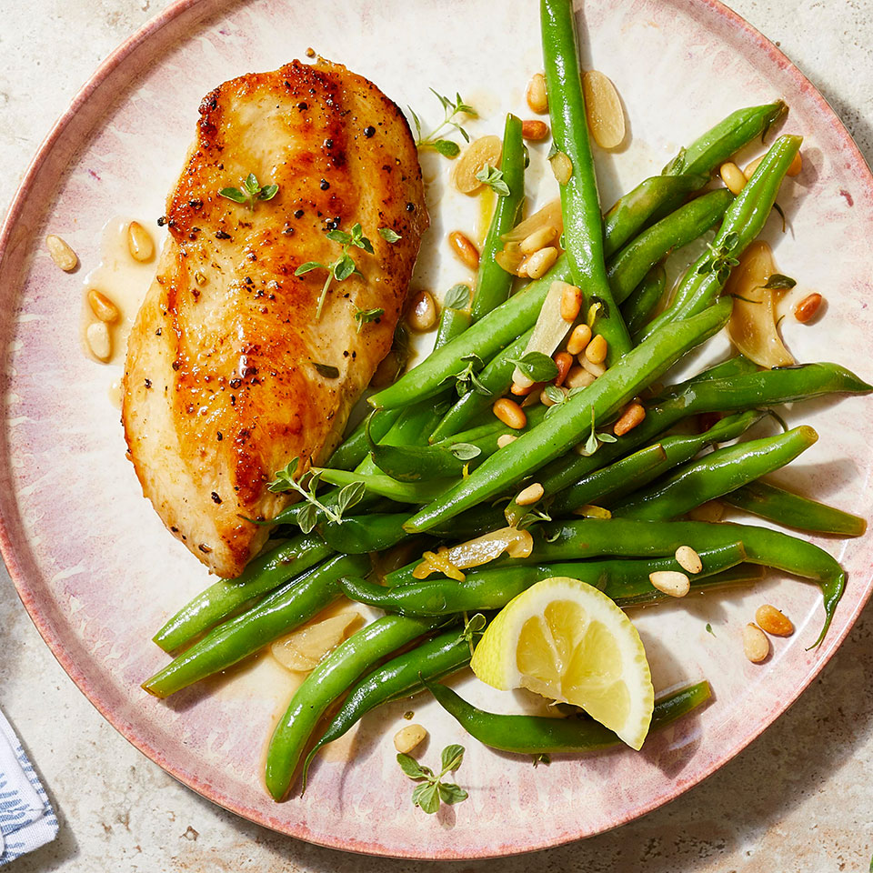 This easy lemon-garlic chicken recipe calls for cutlets, which cook in less than 10 minutes! Can't find them? Make your own from chicken breasts. Place each breast on a cutting board and, with your knife parallel to the board, slice into the skinny side of the chicken breast in a single smooth motion. The side of green beans is cooked right in the same pan as the chicken, so this 20-minute easy, healthy dinner is not just a snap to prepare—the cleanup is a cinch too.