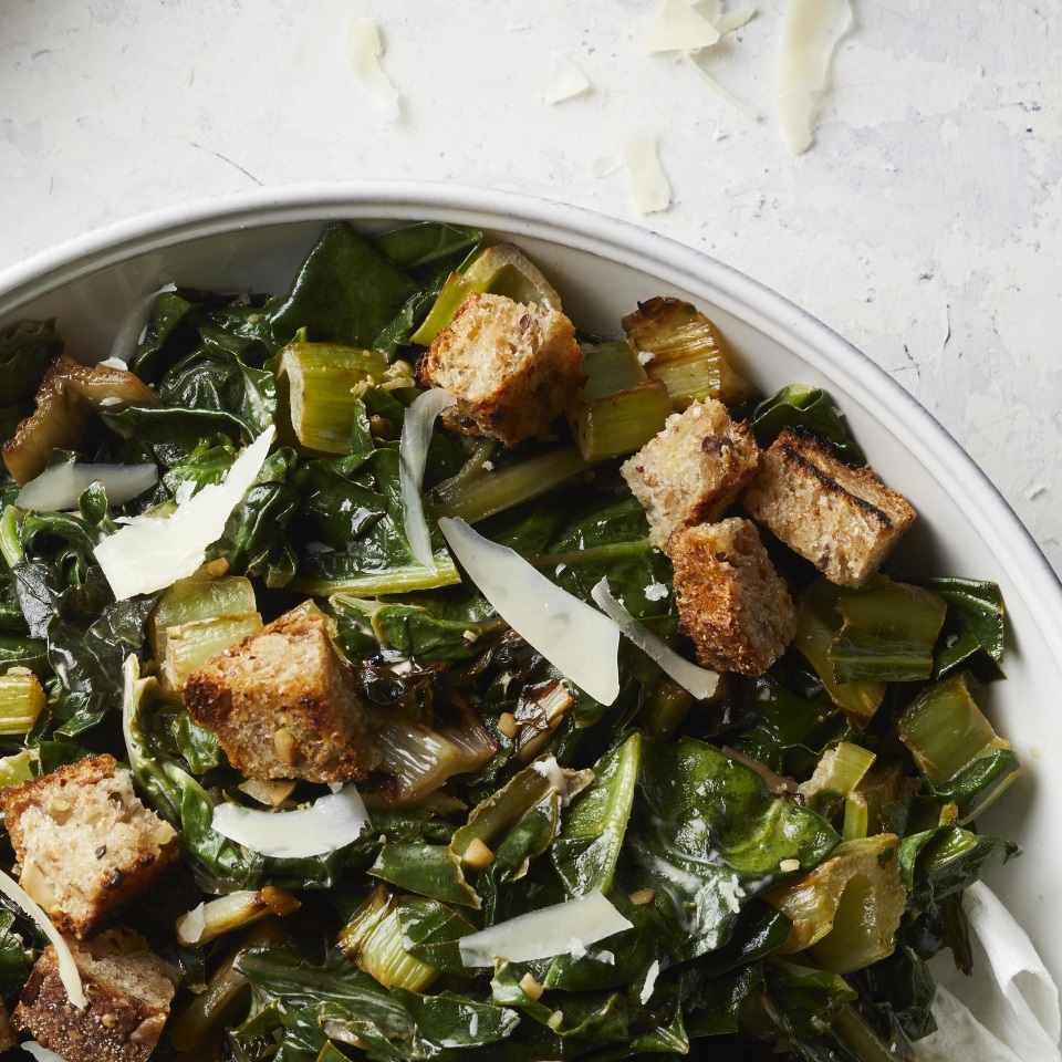 Caesar salad, croutons and all, meets sautéed Swiss chard in this healthy side dish recipe. Serve along with roasted or baked chicken or fish for a healthy weeknight dinner.