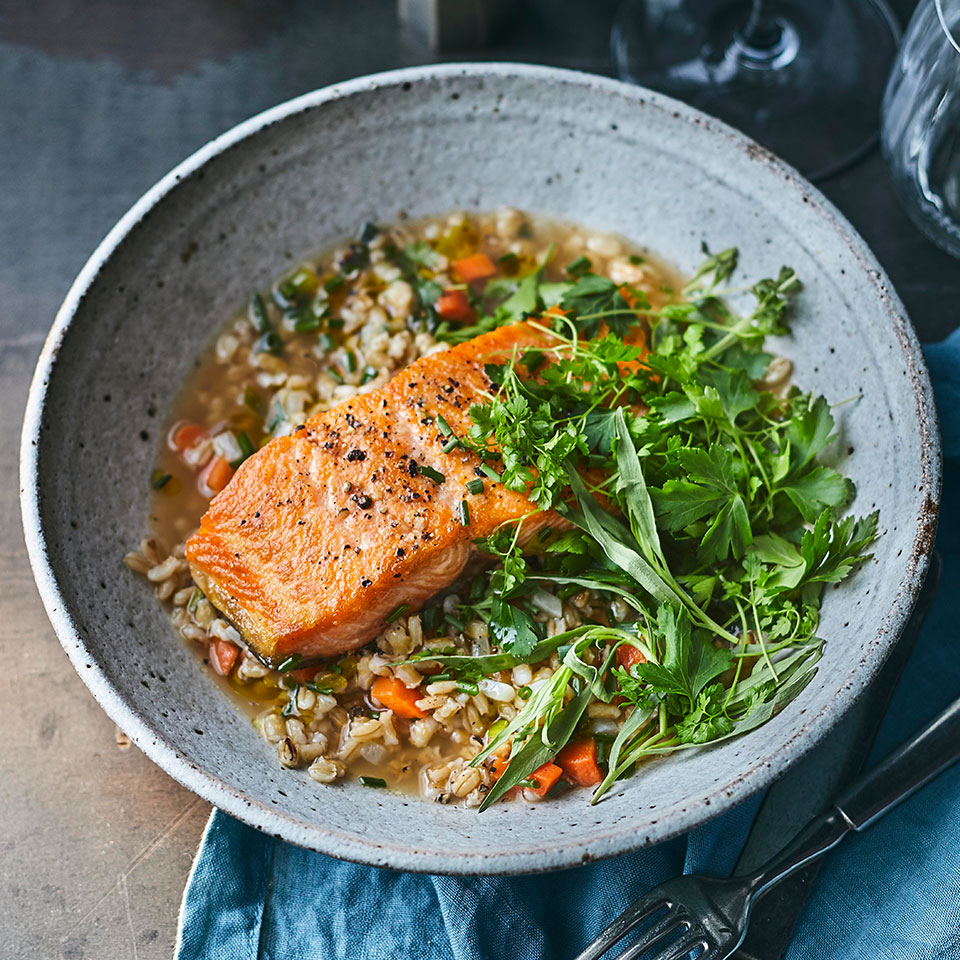 Steelhead and rainbow trout are the same species, but steelhead are anadromous, meaning that, like salmon, they migrate from the ocean to freshwater to spawn. Salmon and arctic char are a good substitute if you have trouble finding steelhead. The creamy barley the fish is served with has a texture similar to risotto, and toasting the grains before cooking gives the dish a nutty flavor. A knob of fresh horseradish is worth seeking out for this; it has a more nuanced flavor than jarred. Serve this healthy fish recipe with a glass of chenin blanc for an elegant and hearty dinner.