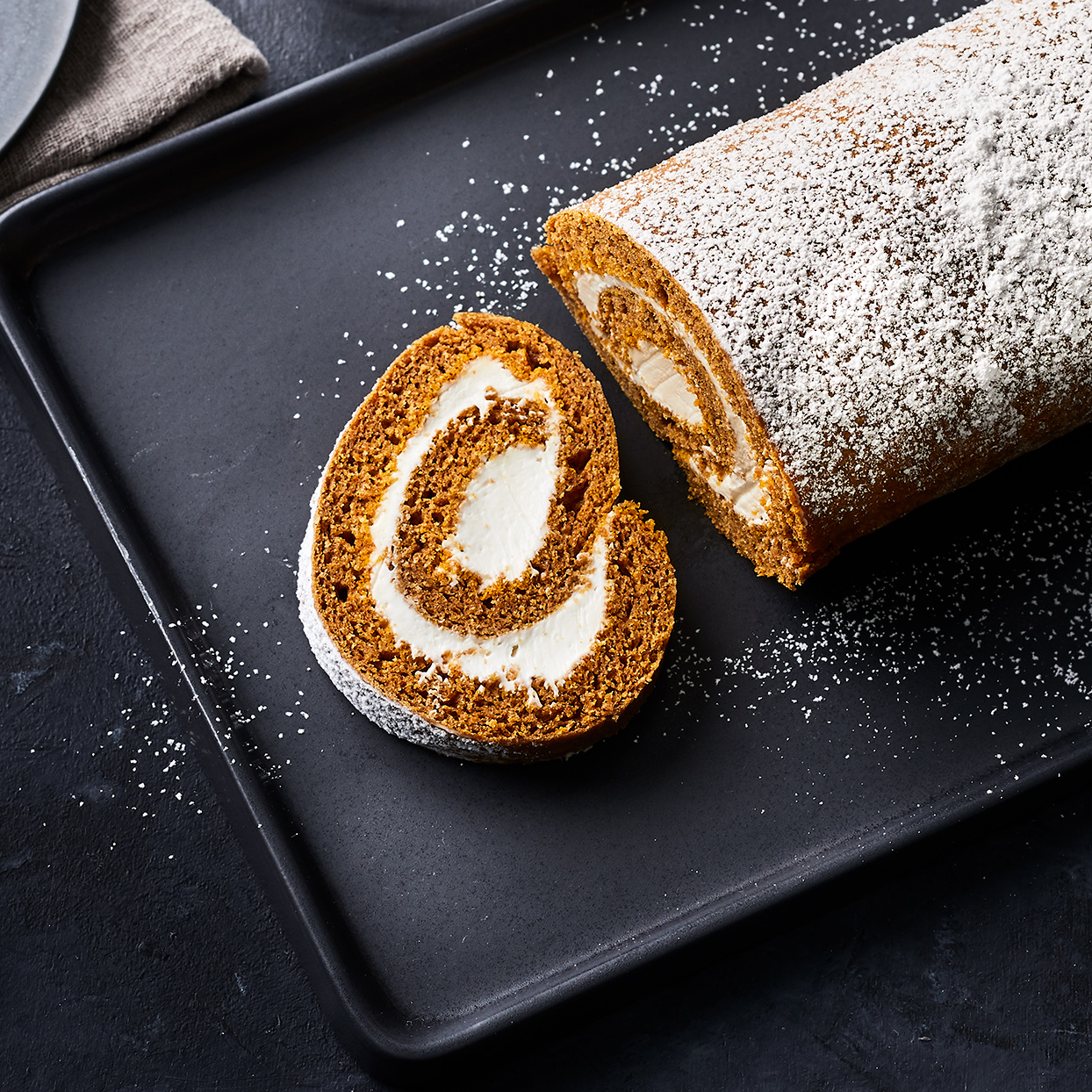 Deliciously warm spiced cake layers are rolled together with slightly tangy cream cheese frosting. This pumpkin jelly roll tastes decadent, but each serving is under 200 calories and has less than 20 grams of sugar. Don't be intimidated by this jelly roll—so long as you work quickly while the cake is warm, it's hard to mess it up or crack the cake.