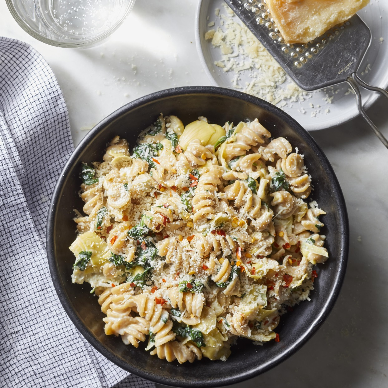 If you've ever wanted to make a meal out of warm spinach and artichoke dip, this creamy pasta is for you. And here's what's almost as good as the flavor of this comforting dish: the fact that this healthy dinner takes just 20 minutes to prepare.
