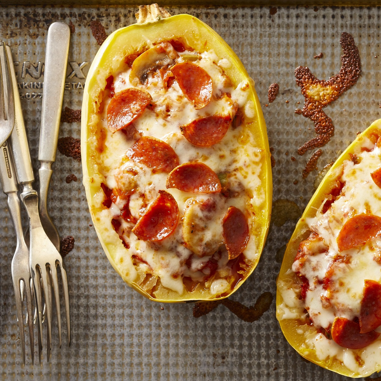 Skip the dough and stuff all of your favorite pizza toppings into spaghetti squash boats for a fun and healthy dinner that'll please the whole family. We love the combination of mushrooms, bell peppers, pepperoni and mozzarella, but feel free to mix it up with your favorite pizza ingredients. You could throw in a bit of chopped cooked broccoli, for example, or add some olives or chopped artichoke hearts. And of course feel free to omit the pepperoni to make the dish vegetarian. Round out the meal with a simple salad.