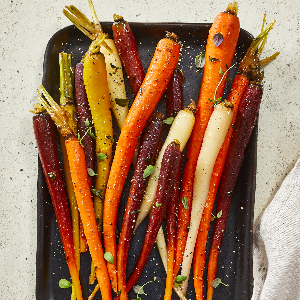 Bright and fresh, these candied carrots have just a hint of sweetness from the honey and citrus. This one-pan dish is quick and easy to make, but also has such a pretty presentation that it works both as an entertaining-worthy or weeknight side dish. Look for carrots that are similar in size so they cook evenly.