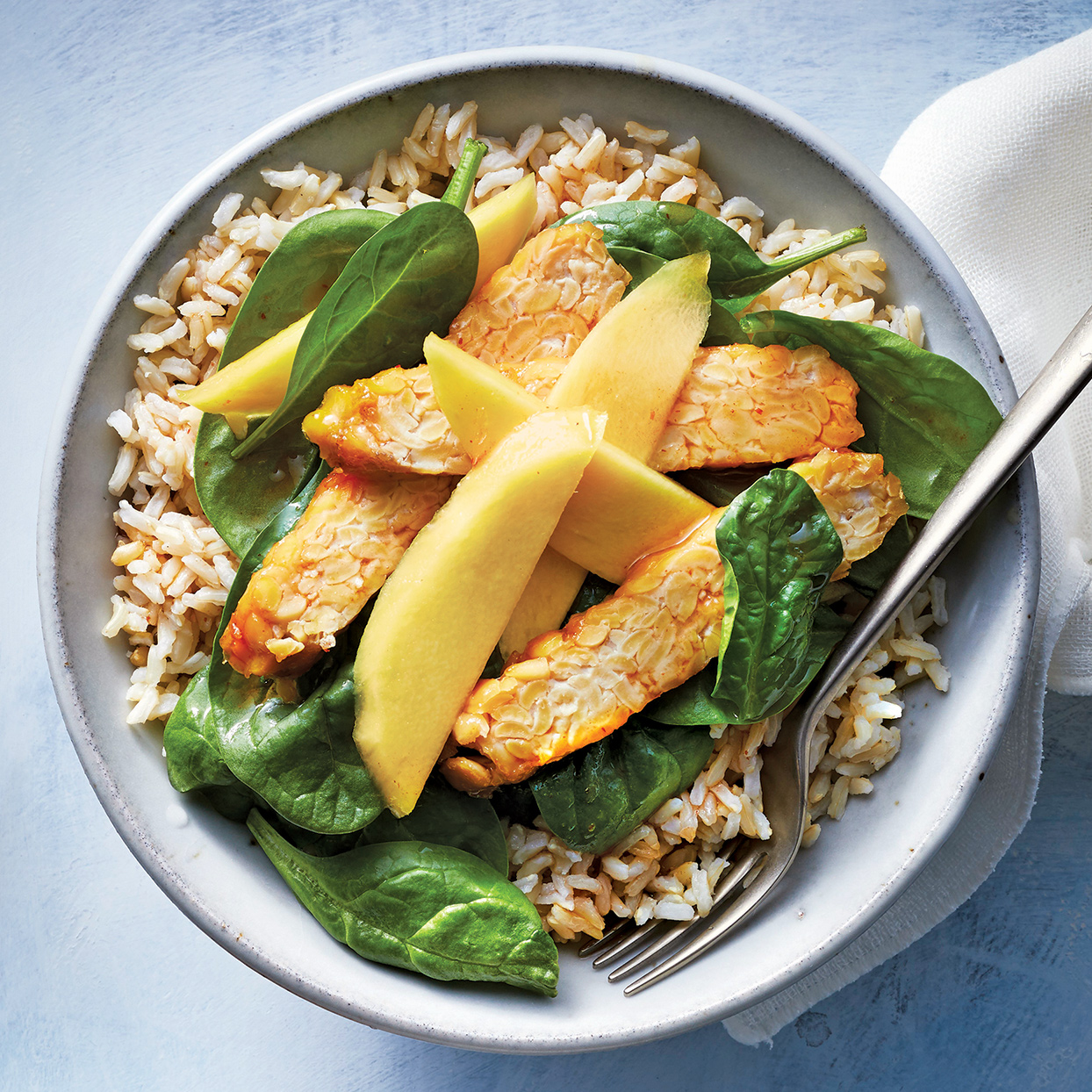 Making a flavorful, well-balanced meatless dish doesn't get simpler than this. Sweet mango is the right complement to the earthy tempeh. A drizzle of the sweet and salty cooking liquid is the perfect addition of moisture and brightness.