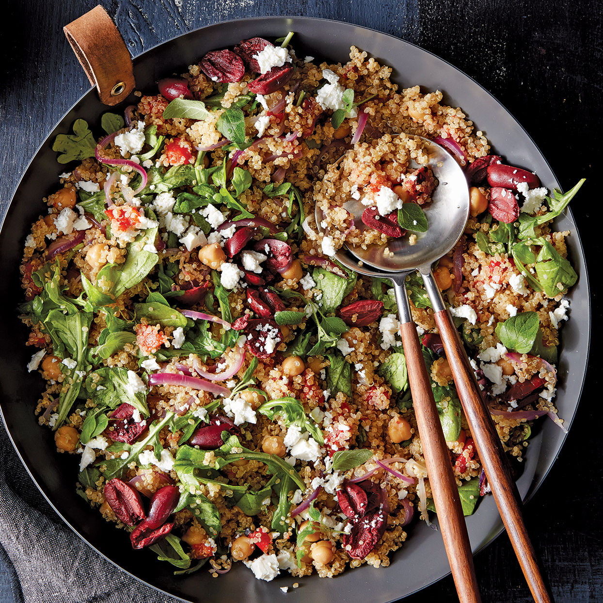 Chock-full of quinoa, chickpeas and vegetables, this salad is a meal in itself. The roasted red peppers, lemon, olives and feta add familiar Mediterranean flavor.