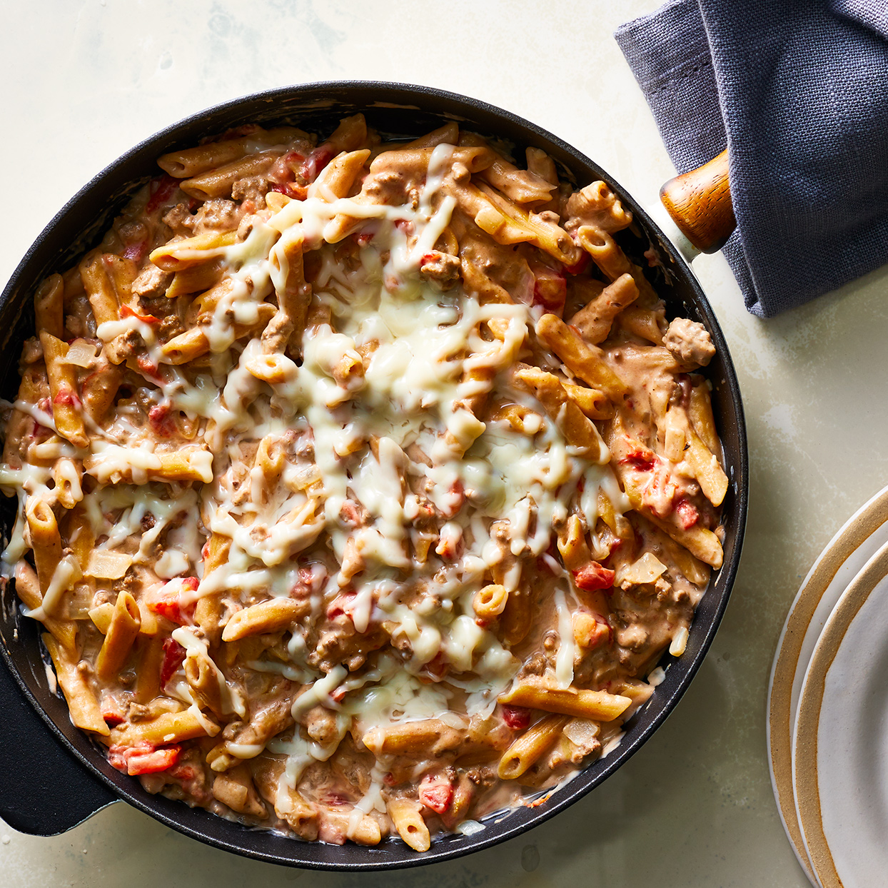 Pastitsio is a classic Greek baked pasta dish made with ground beef and bechamel. Our version has all the flavors and the comforting feel of the classic, but is made in one skillet (less cleanup!) and is healthier for you, using whole-grain pasta, lean meat and low-fat dairy.