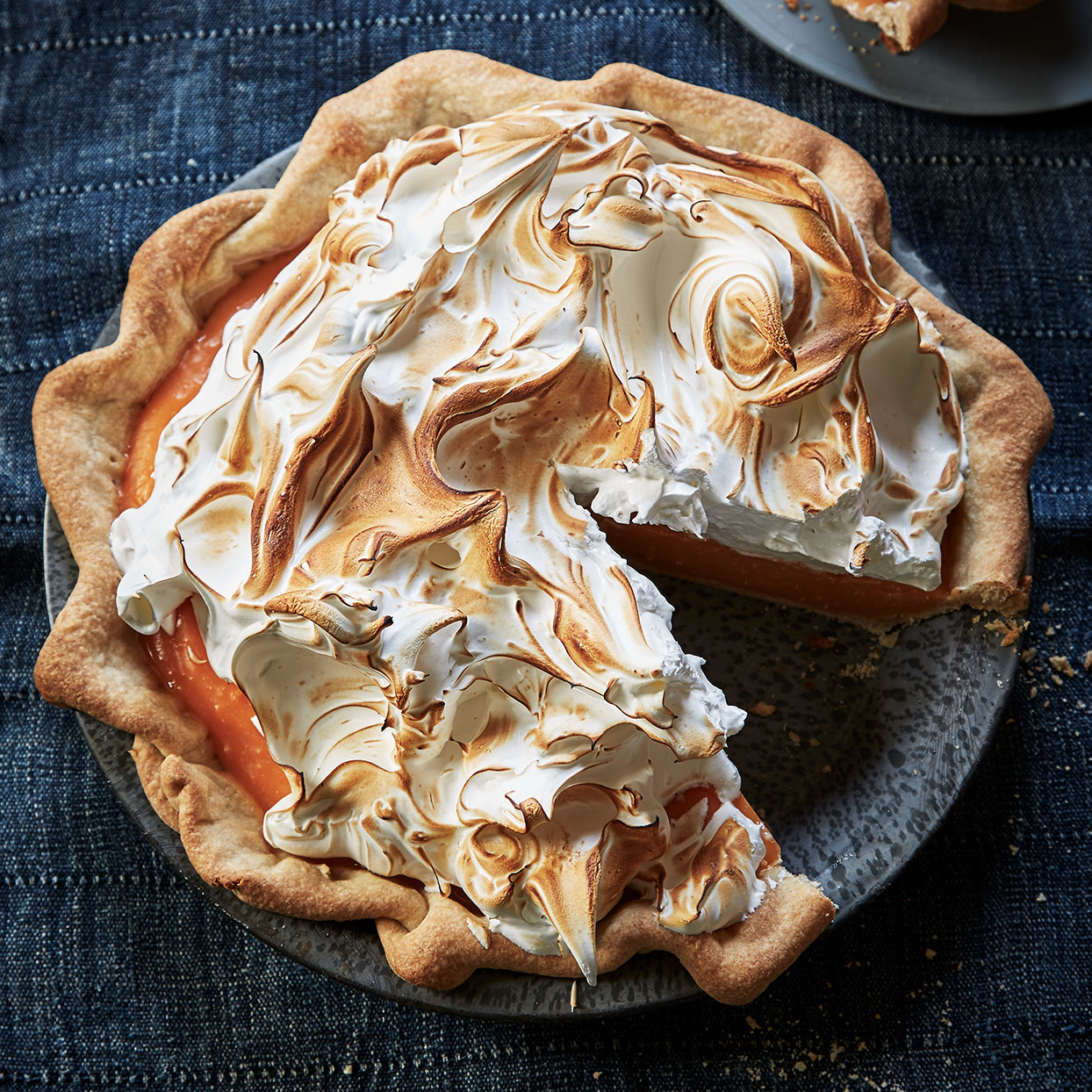 For this pie's filling we call for fresh squeezed grapefruit juice, but store-bought (not frozen) works well and may even give you more brightly colored results. The Italian meringue topping is made by beating hot sugar syrup into egg whites that are already beaten to stiff peaks. It's a bit more effort, but the meringue holds its shape longer.