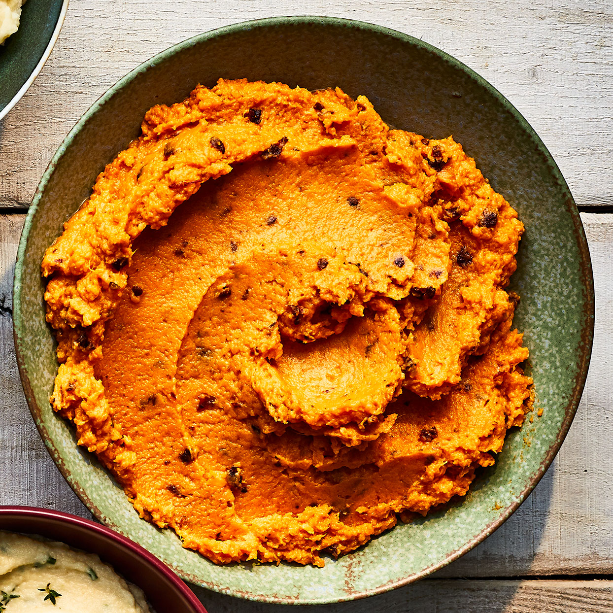 These healthy mashed sweet potatoes owe their kick to the chipotle peppers. Want it spicier? Add another tablespoon to your mash. You can even use chipotle chile powder to punch up the heat—use a couple teaspoons instead of the full 3 tablespoons of chipotles in adobo.