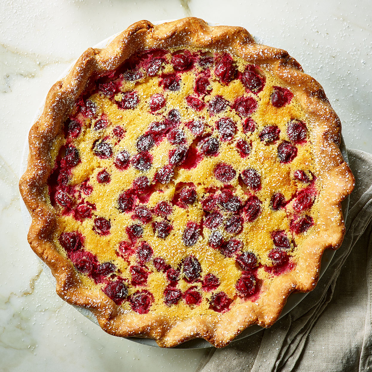 This custard filling is what takes this buttermilk pie recipe to the next level. It tastes like a panna cotta with a bit of attitude from the tang of the buttermilk and a generous sprinkling of cranberries on top.